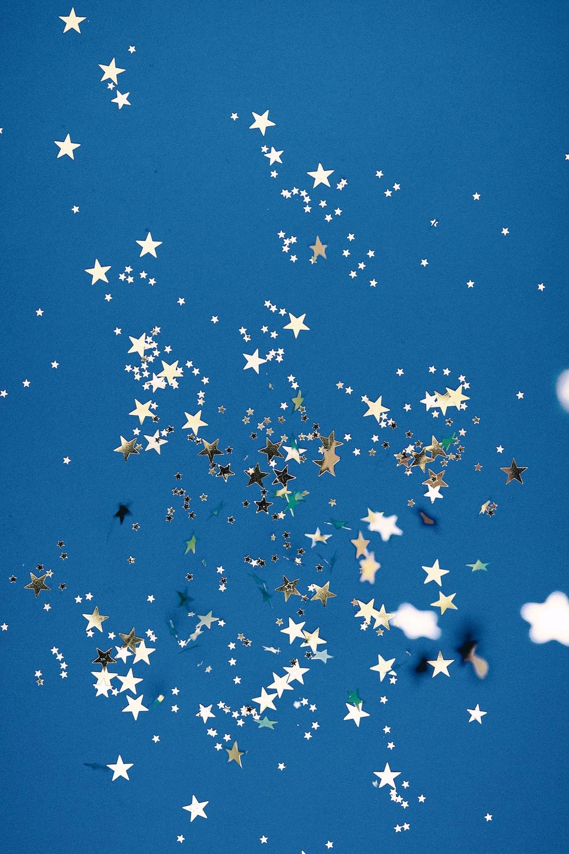 flock of birds flying under blue sky during daytime