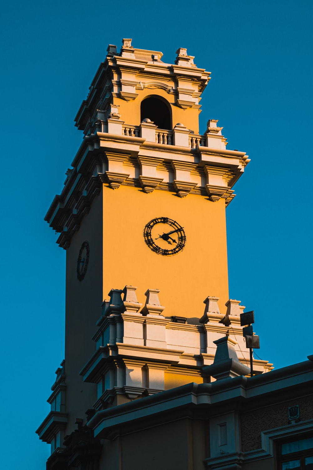 brown and white clock tower