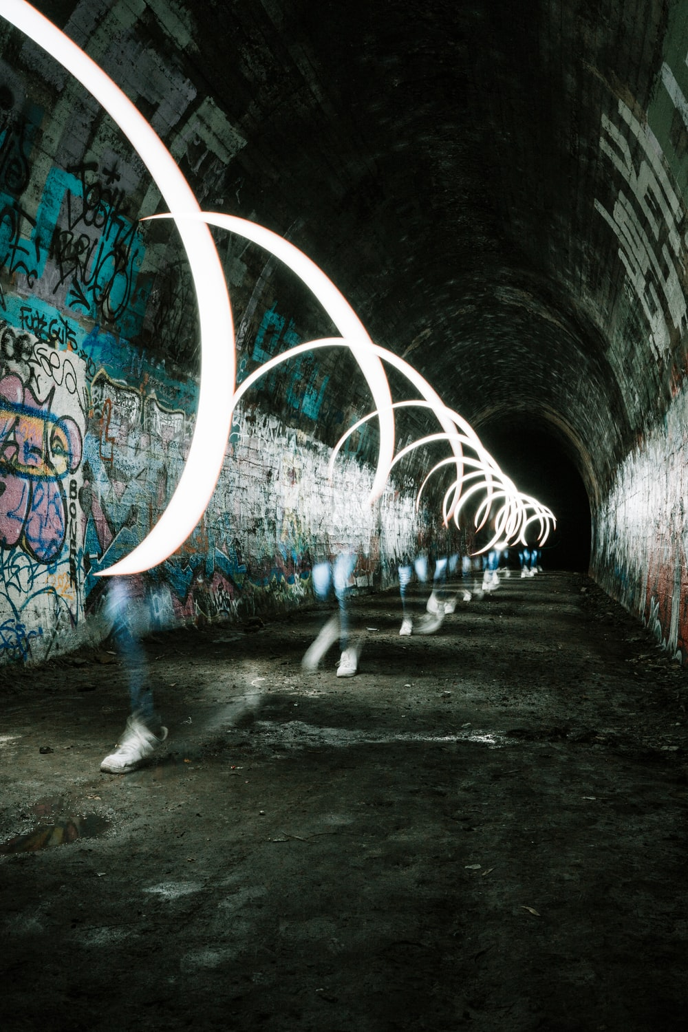 person walking on tunnel during daytime