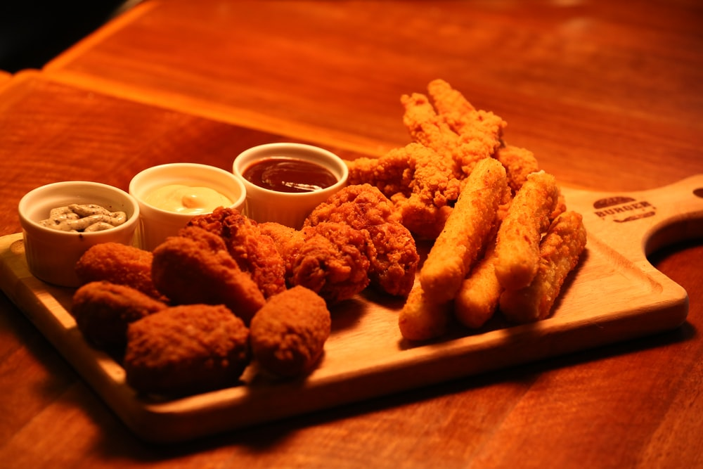 fried food on brown wooden tray