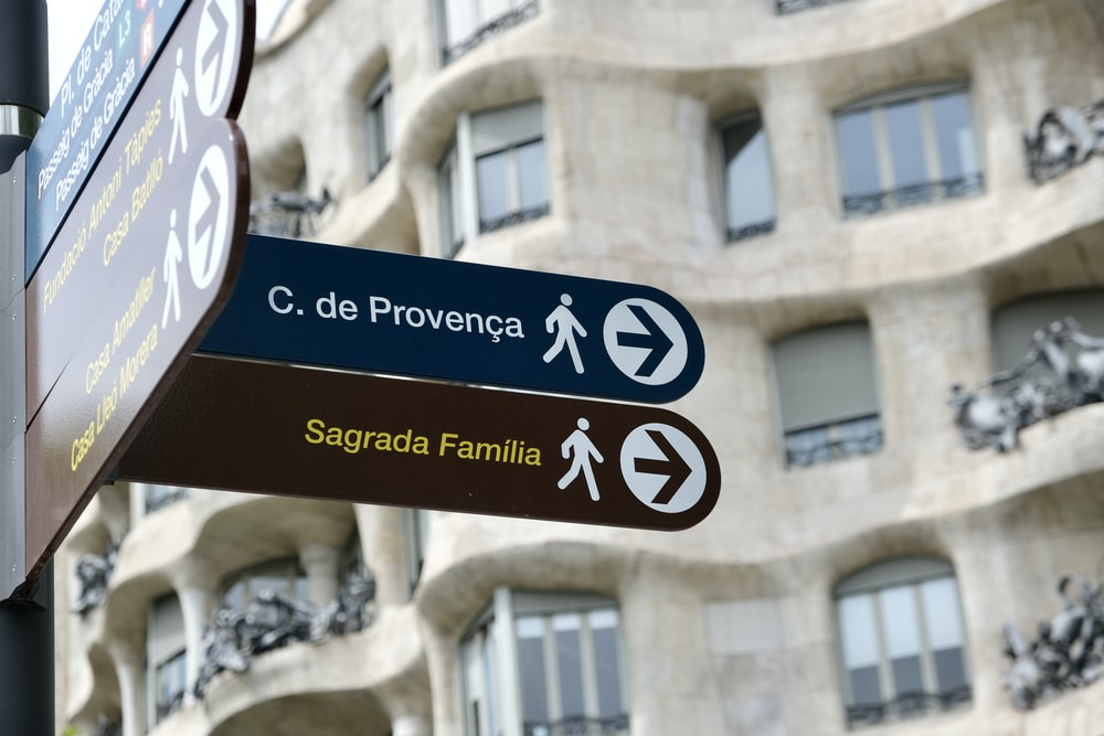 brown and white street sign