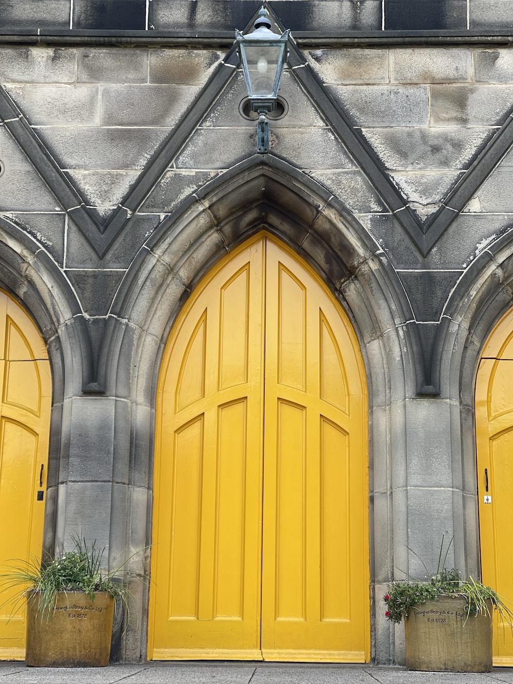 yellow wooden door on gray concrete building
