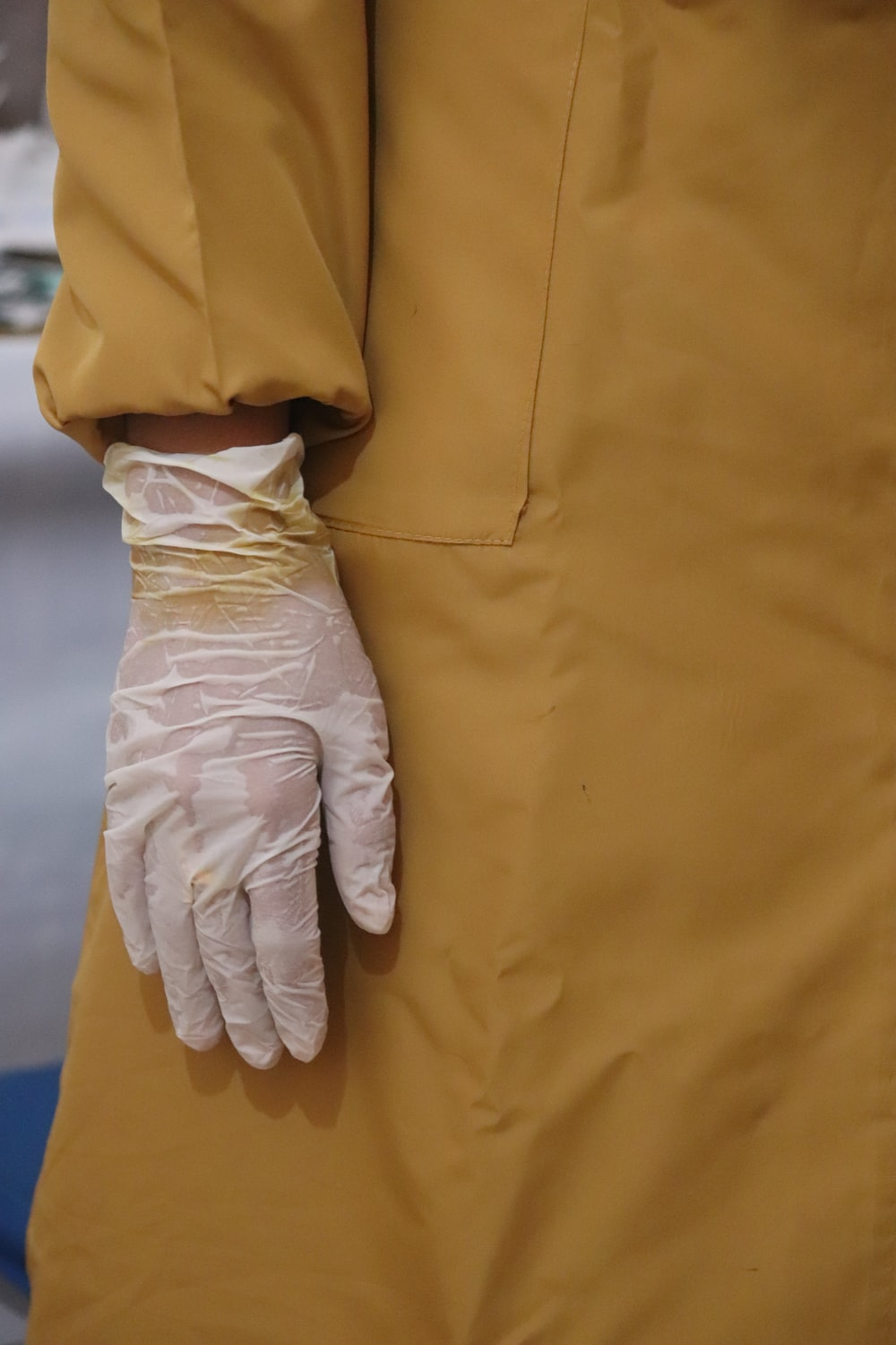 person in white pants and white gloves