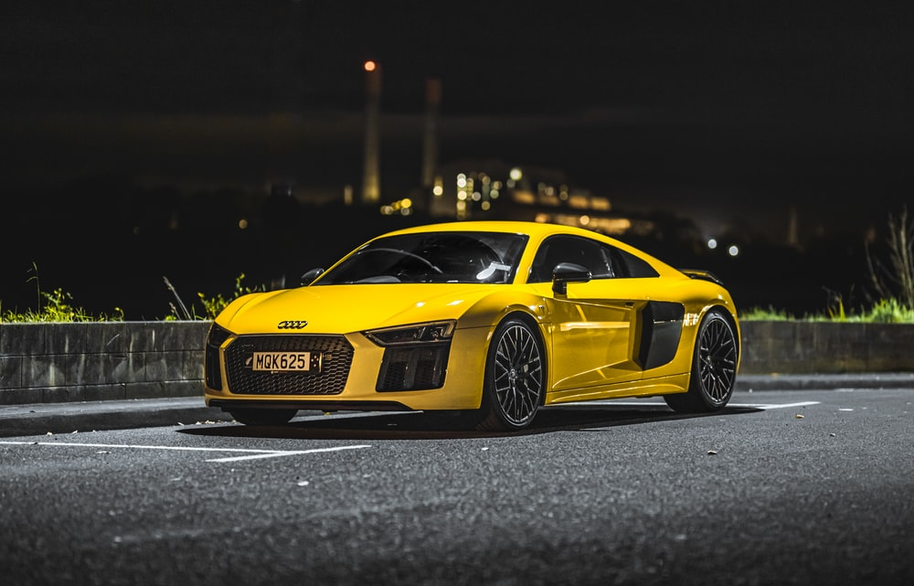 yellow lamborghini aventador on road during night time