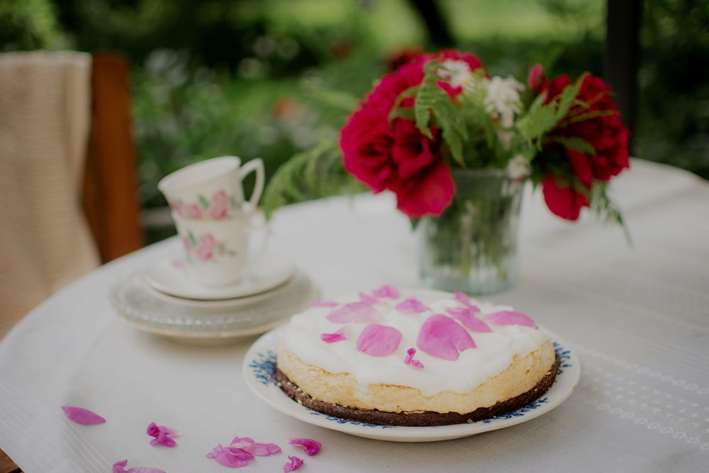 red rose on white ceramic saucer