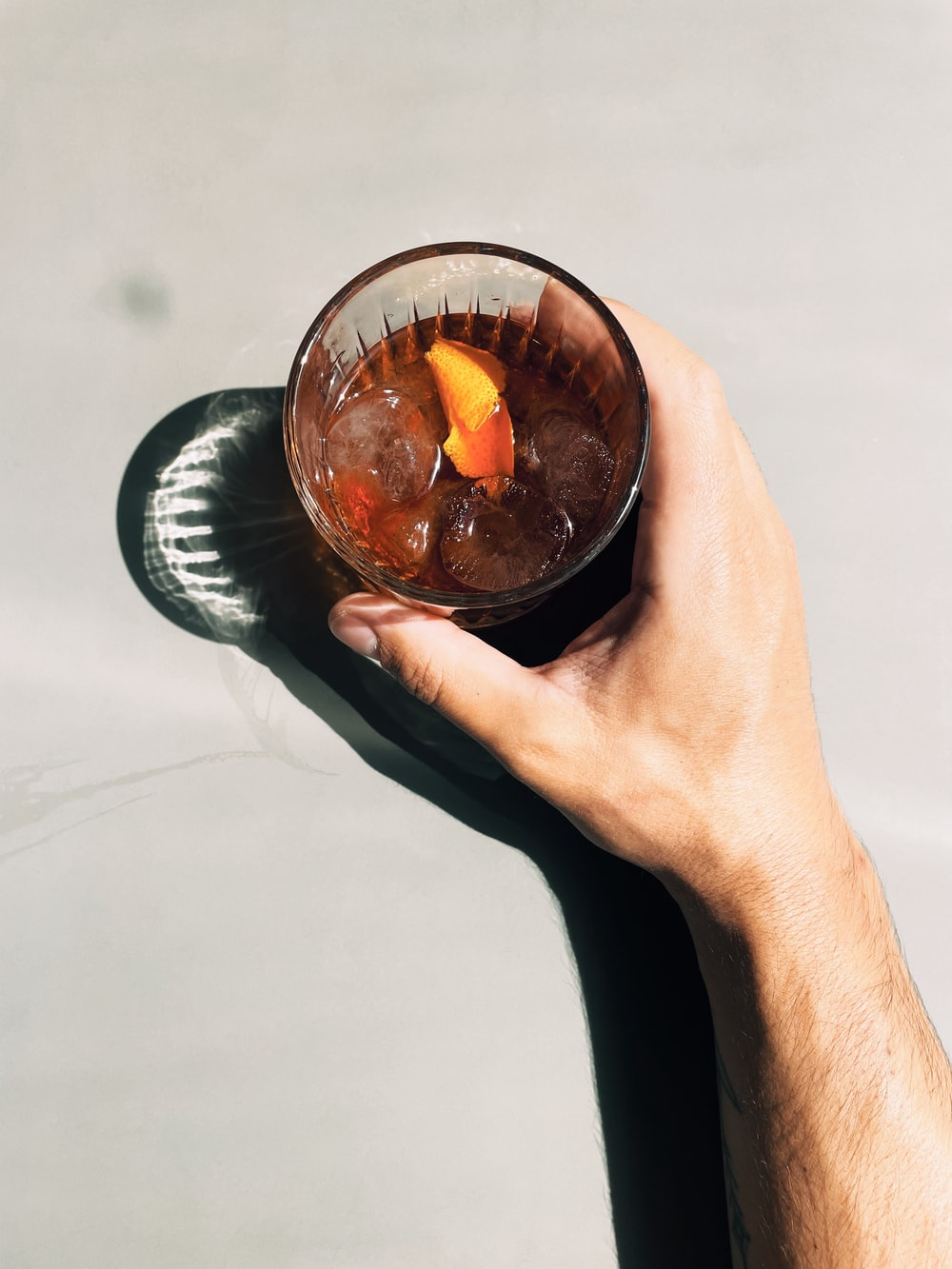 clear glass bowl with orange liquid