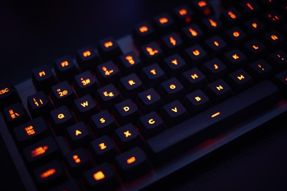 black computer keyboard on black surface