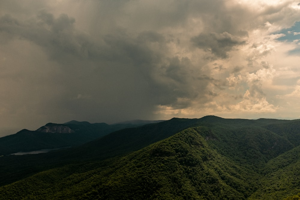 green mountain under white clouds during daytime