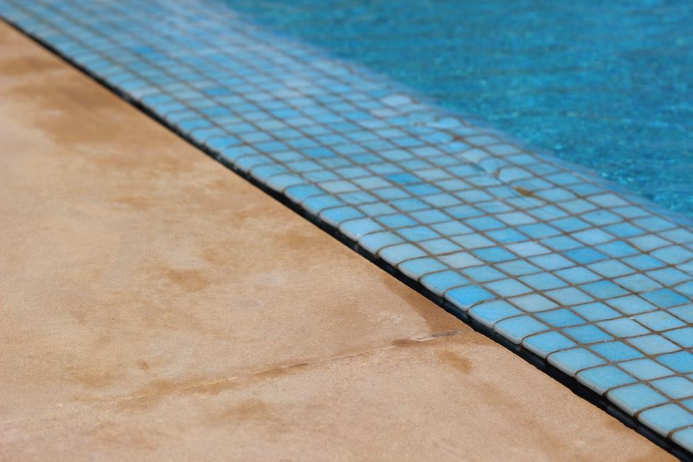 blue swimming pool during daytime