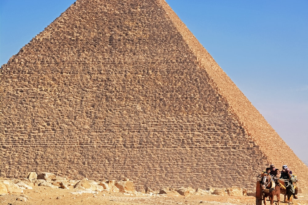 brown pyramid under blue sky during daytime