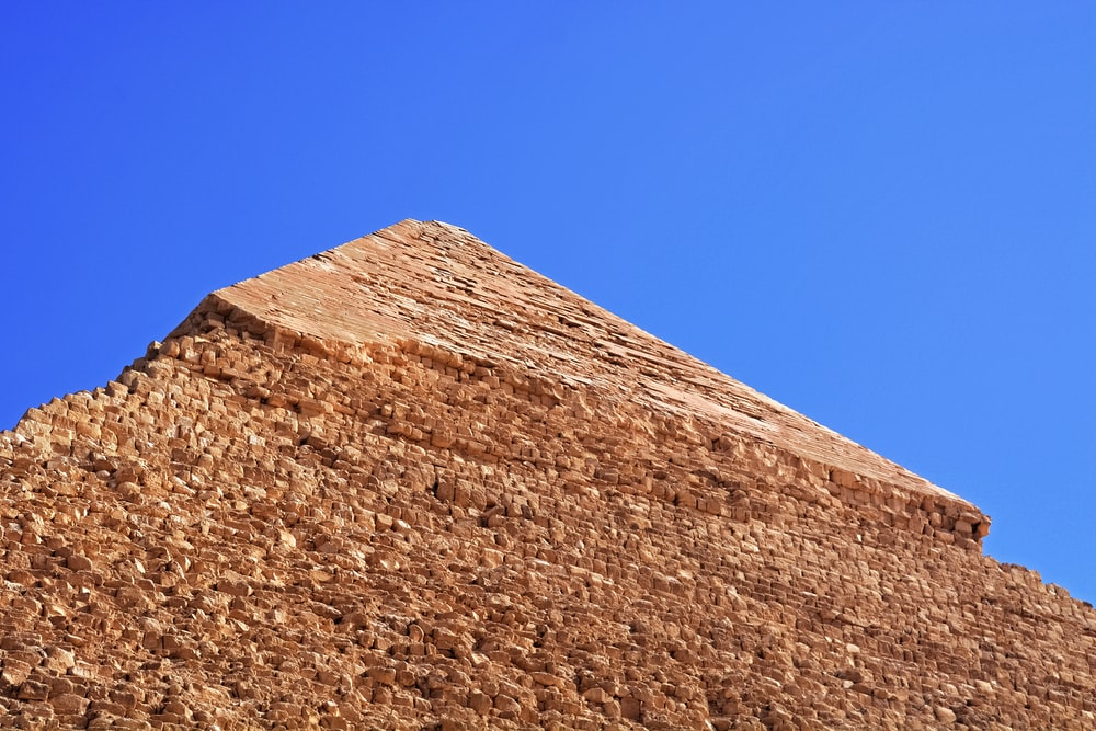 brown concrete wall under blue sky during daytime