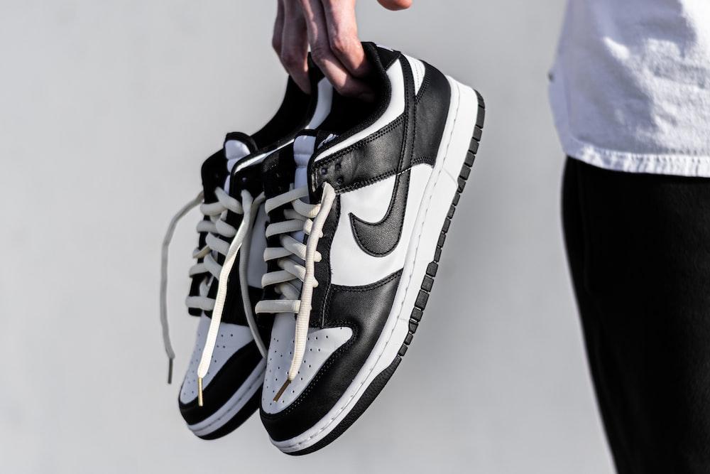 black and white nike athletic shoe