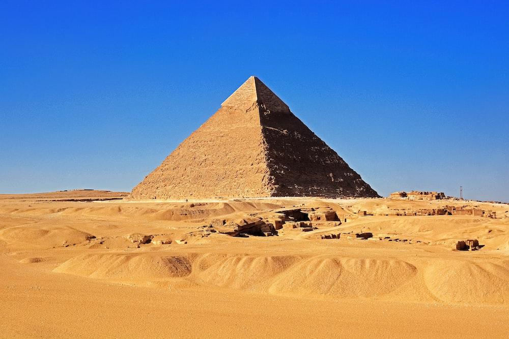 pyramid on desert during daytime