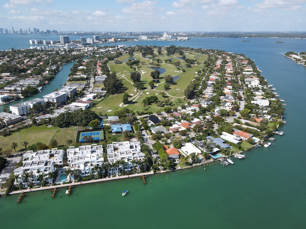 aerial view of city buildings near body of water during daytime