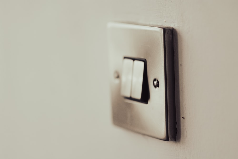 white light switch on white painted wall