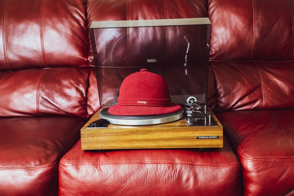 red and black hat on brown wooden table