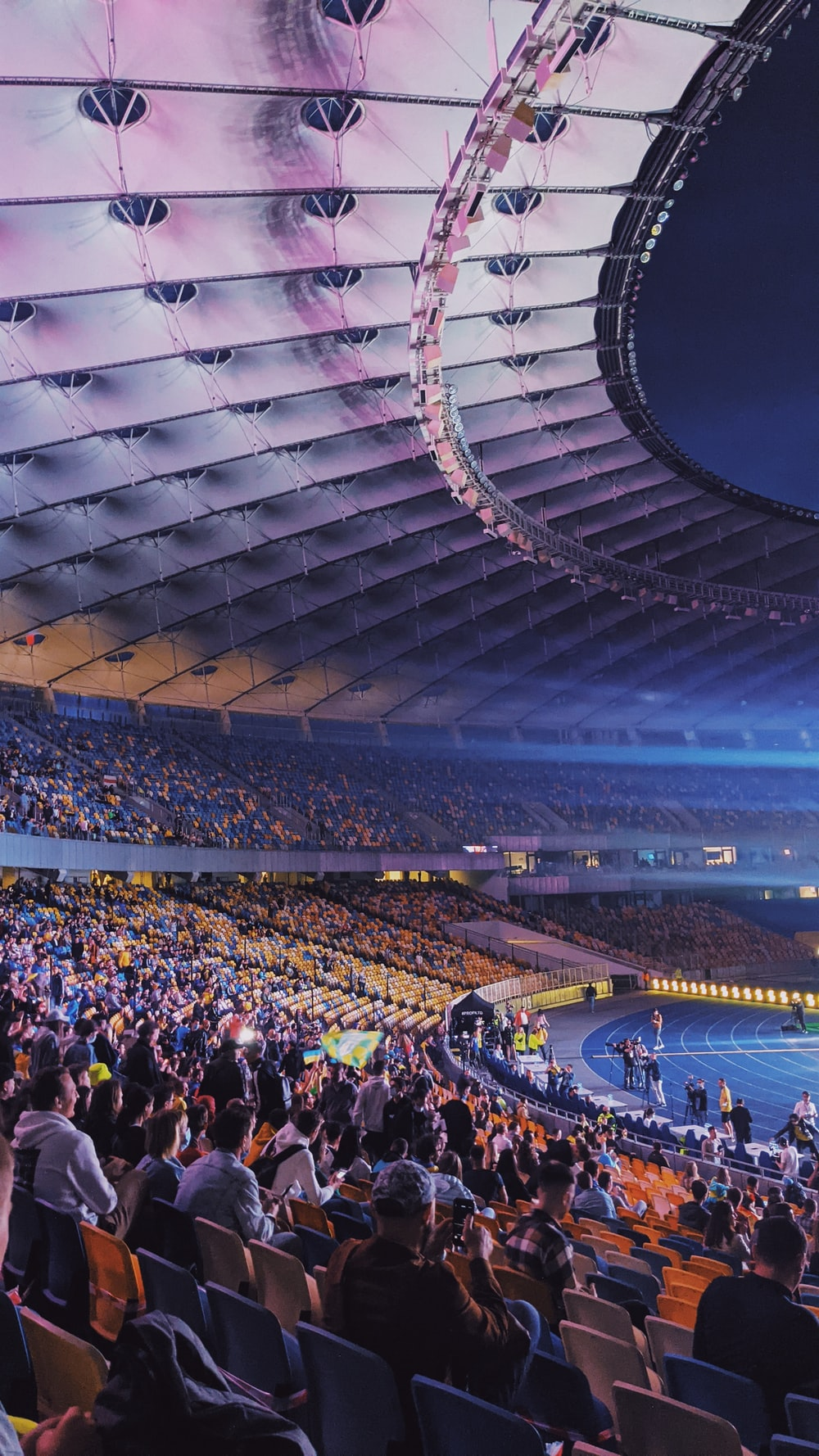 people in stadium during nighttime