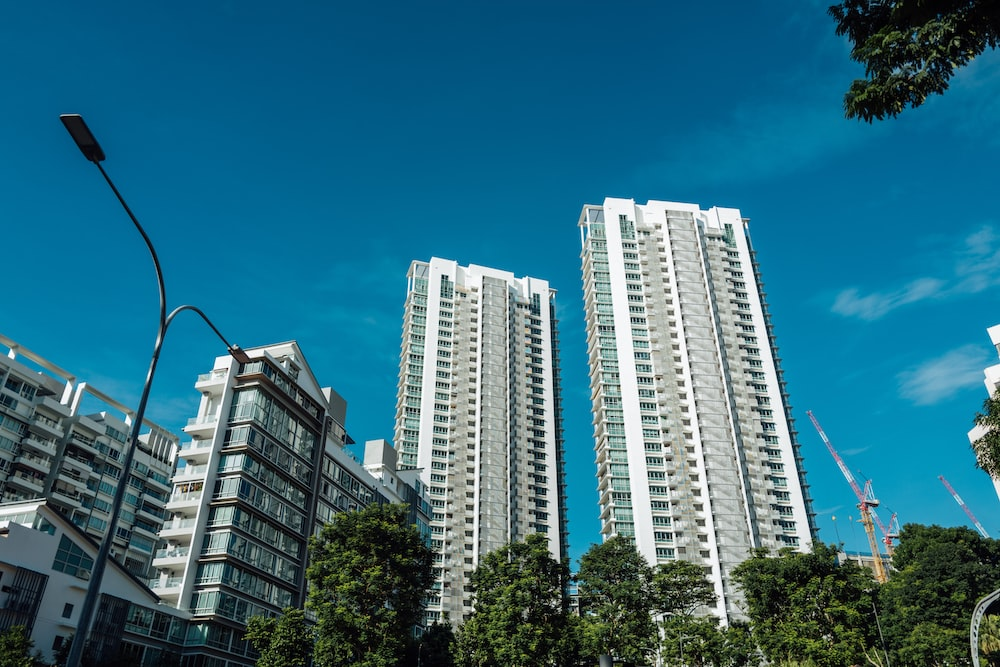 white and blue high rise buildings