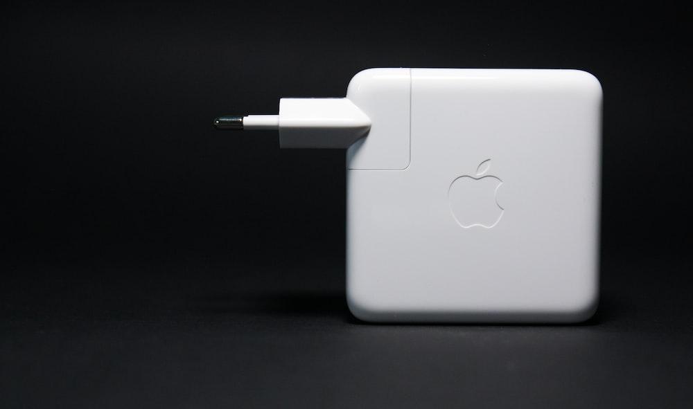 white apple macbook on black surface