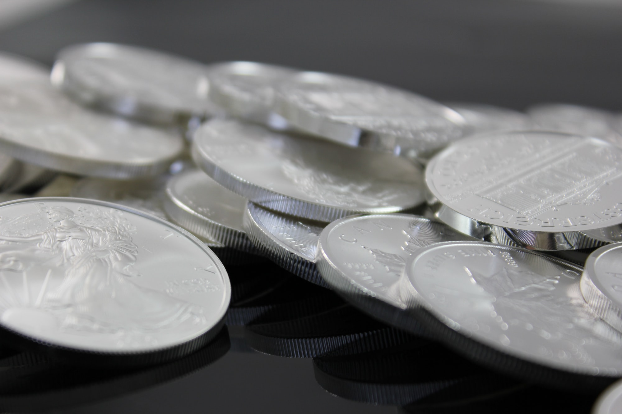 Pile of silver bullion coins. Münze Österreich, Royal Canadian Mint, U.S. Mint, Australian Mint of Perth and Krugerrand. If you use our photos, please add credit to https://zlataky.cz, when possible