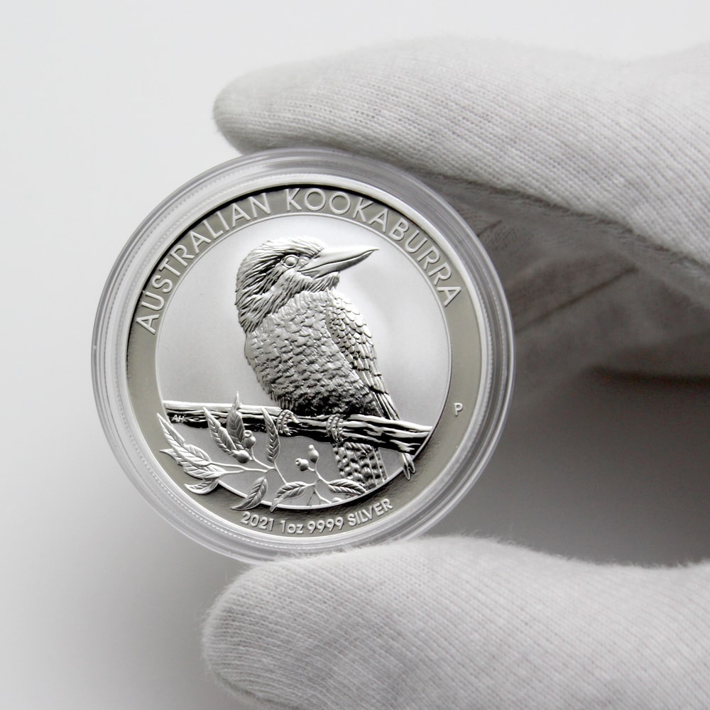 silver and gold round coin