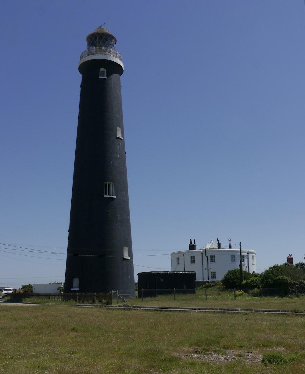 black and white lighthouse under blue sky during daytime