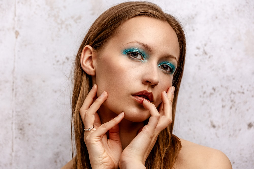 woman with red lipstick and blue eyes
