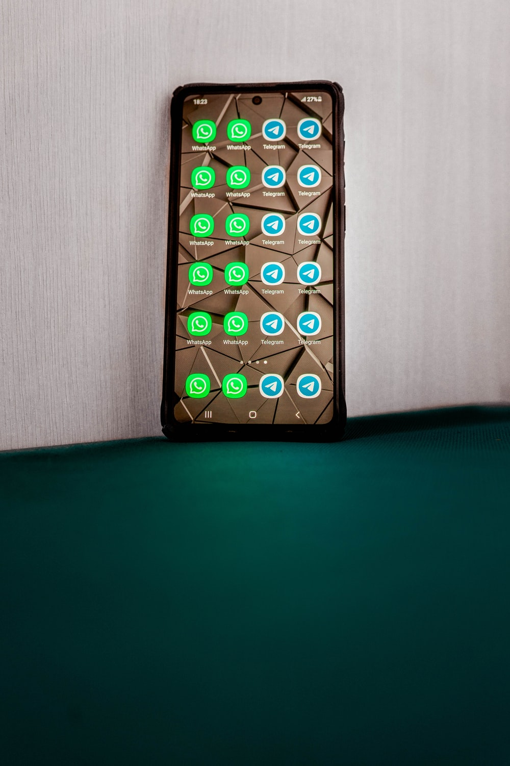 black android smartphone on green surface