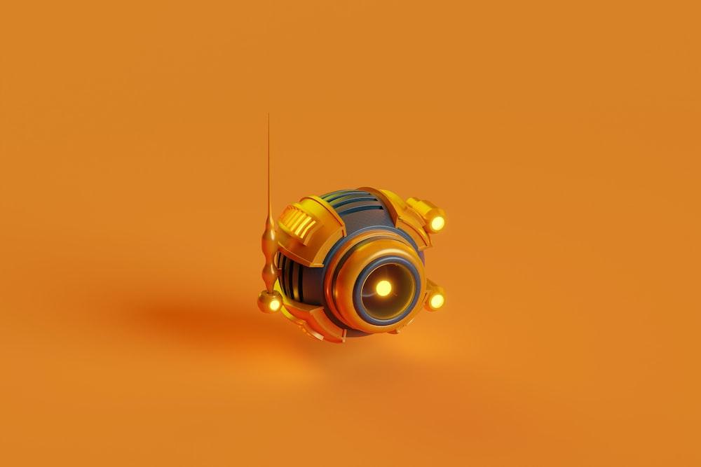 yellow and black camera on orange surface