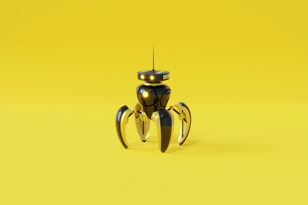 yellow and silver frog figurine