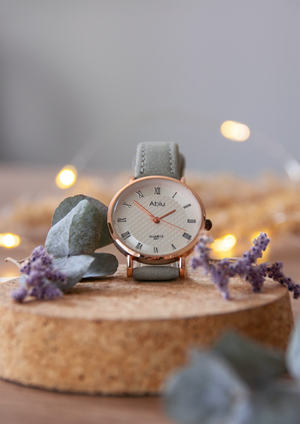 silver round analog watch on brown wooden table