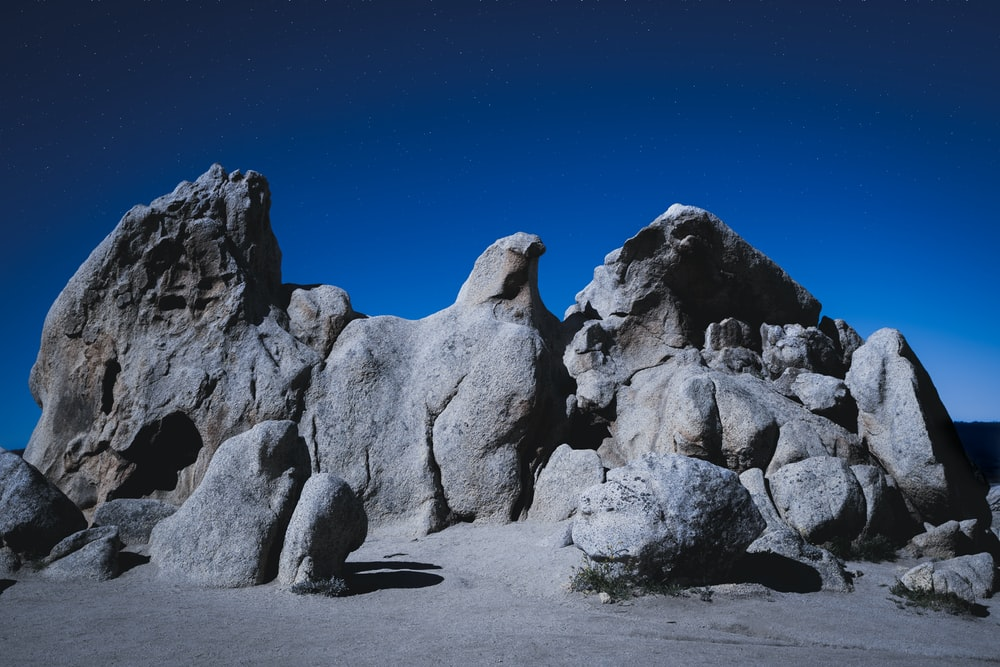 gray rock formation under blue sky during daytime