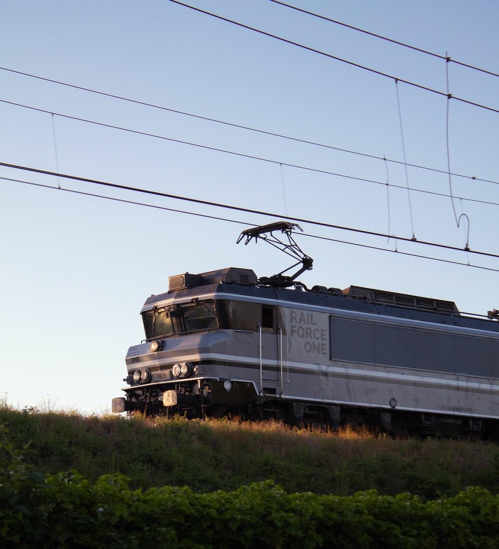 black and white train on rail road