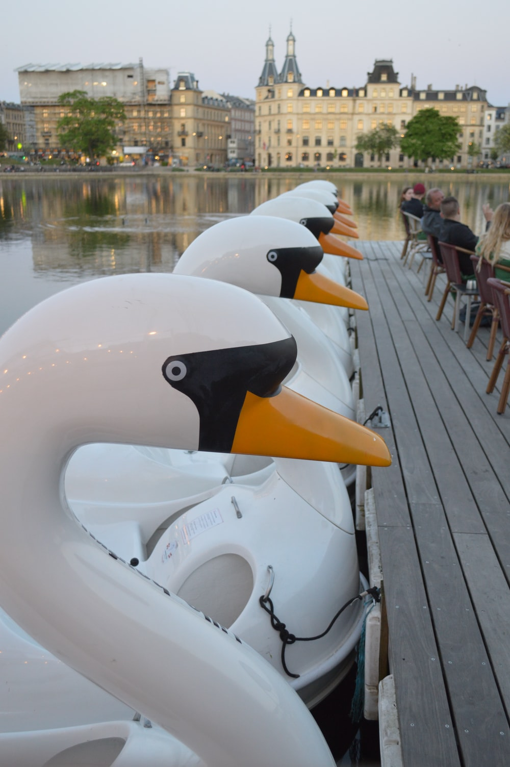 white and black duck inflatable float on dock during daytime