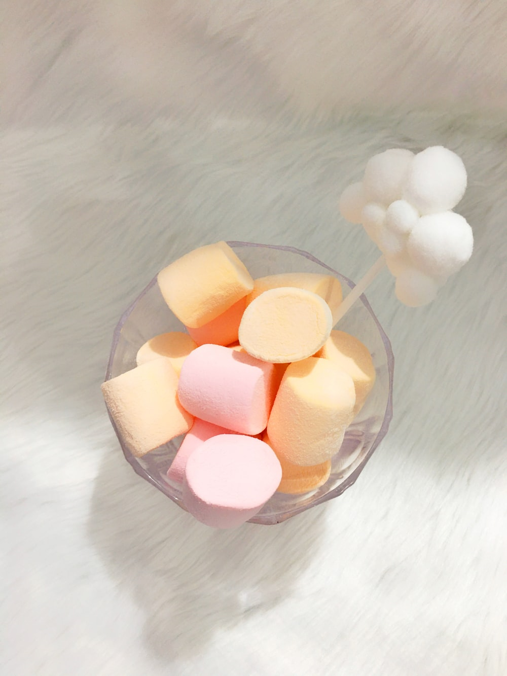 white heart shaped candies in clear glass bowl