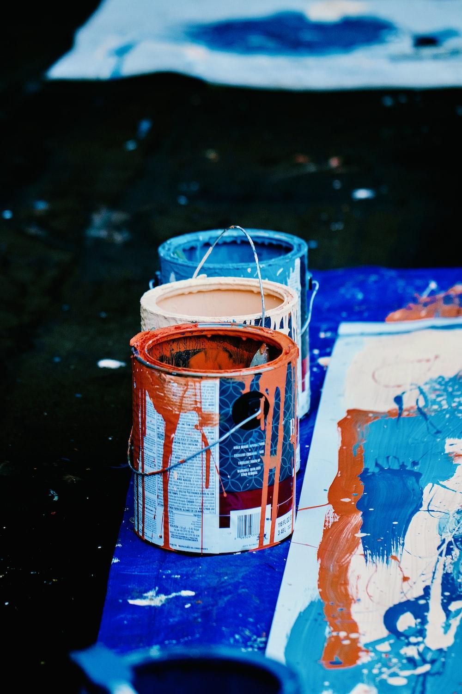 orange and white plastic bucket