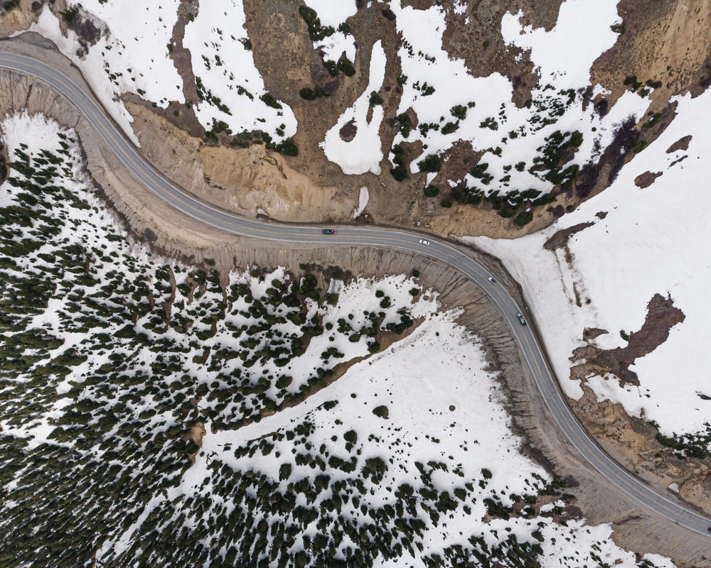 aerial view of road covered with snow