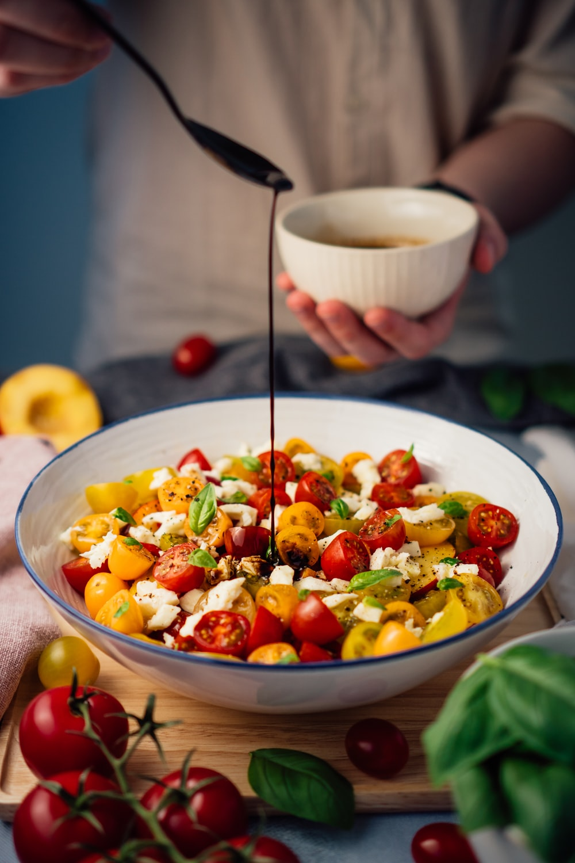 fruit salad on white ceramic bowl