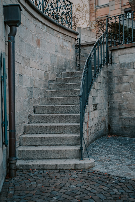 blue metal railings on gray concrete stairs