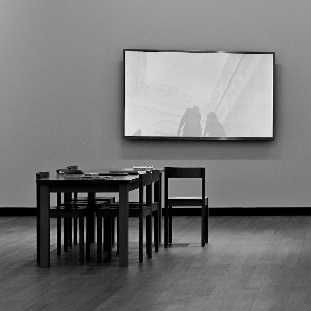 black flat screen tv mounted on white wall
