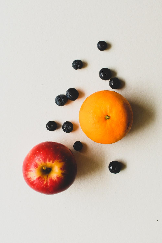 orange fruit beside black and white beads