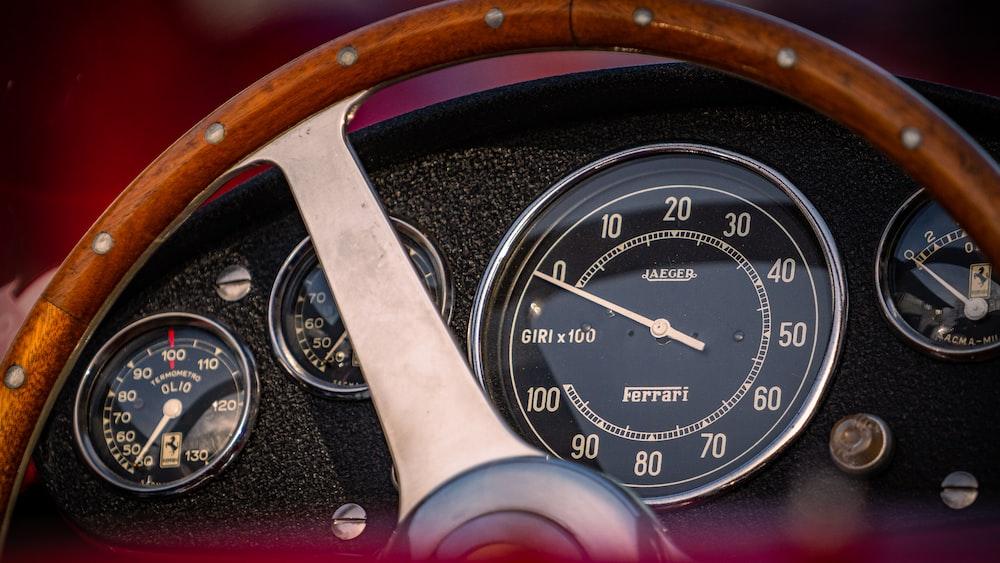 black and brown analog speedometer