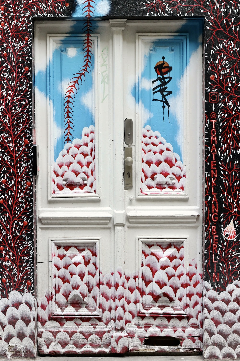 red and blue floral wooden door