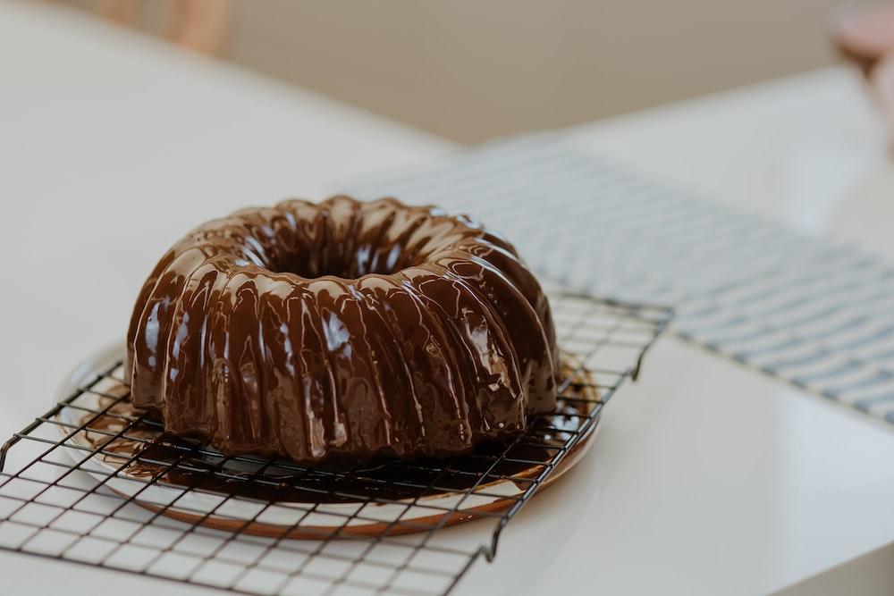 chocolate doughnut on white paper