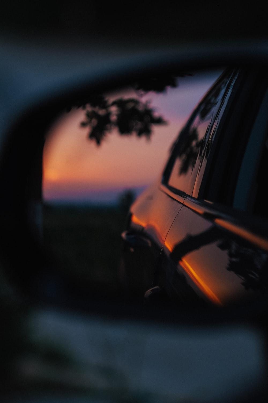 black car side mirror reflecting black car