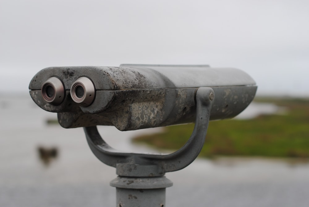 gray and black binoculars in close up photography