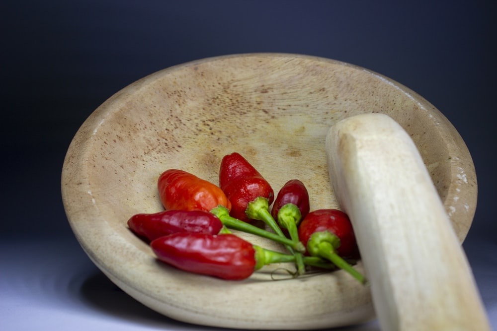 red chili on white ceramic plate