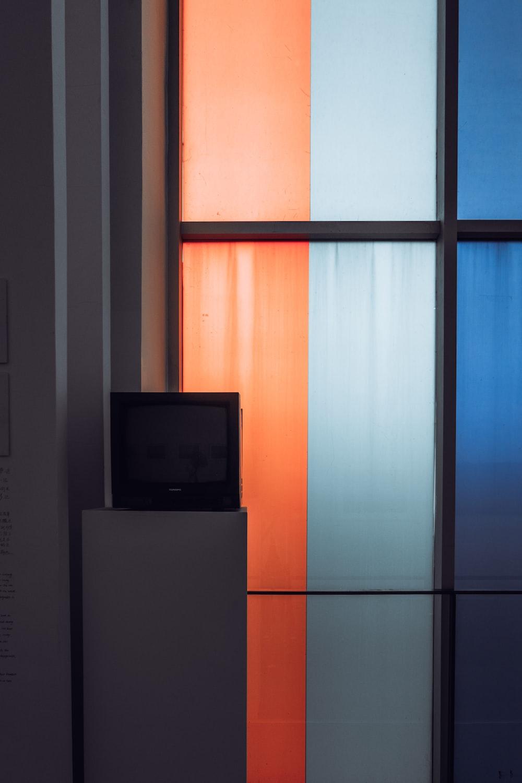 black crt tv on white top mount refrigerator