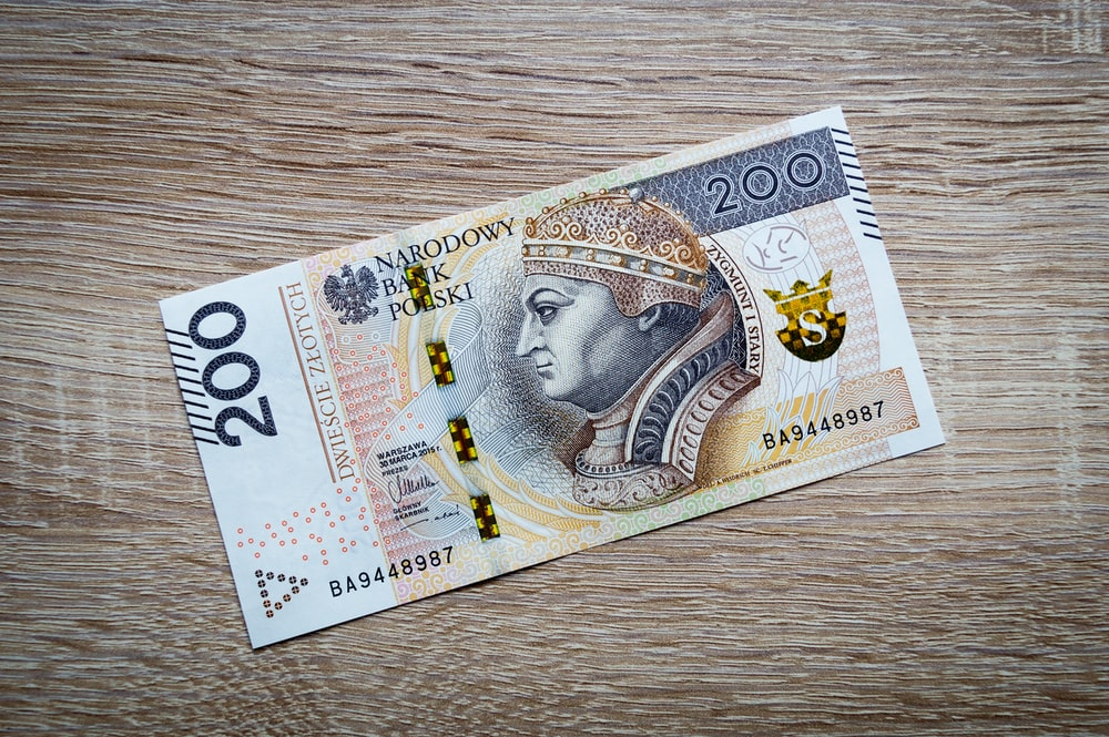 50 banknote on brown wooden table
