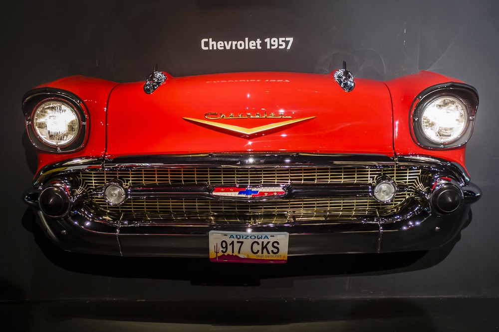 red mercedes benz car in a dark room